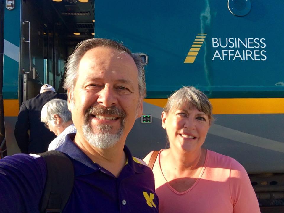 mike venturini and lori venturini man and woman boarding blue canada rail train