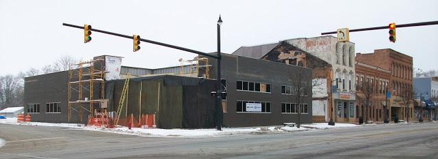 modern building under construction on corner lot