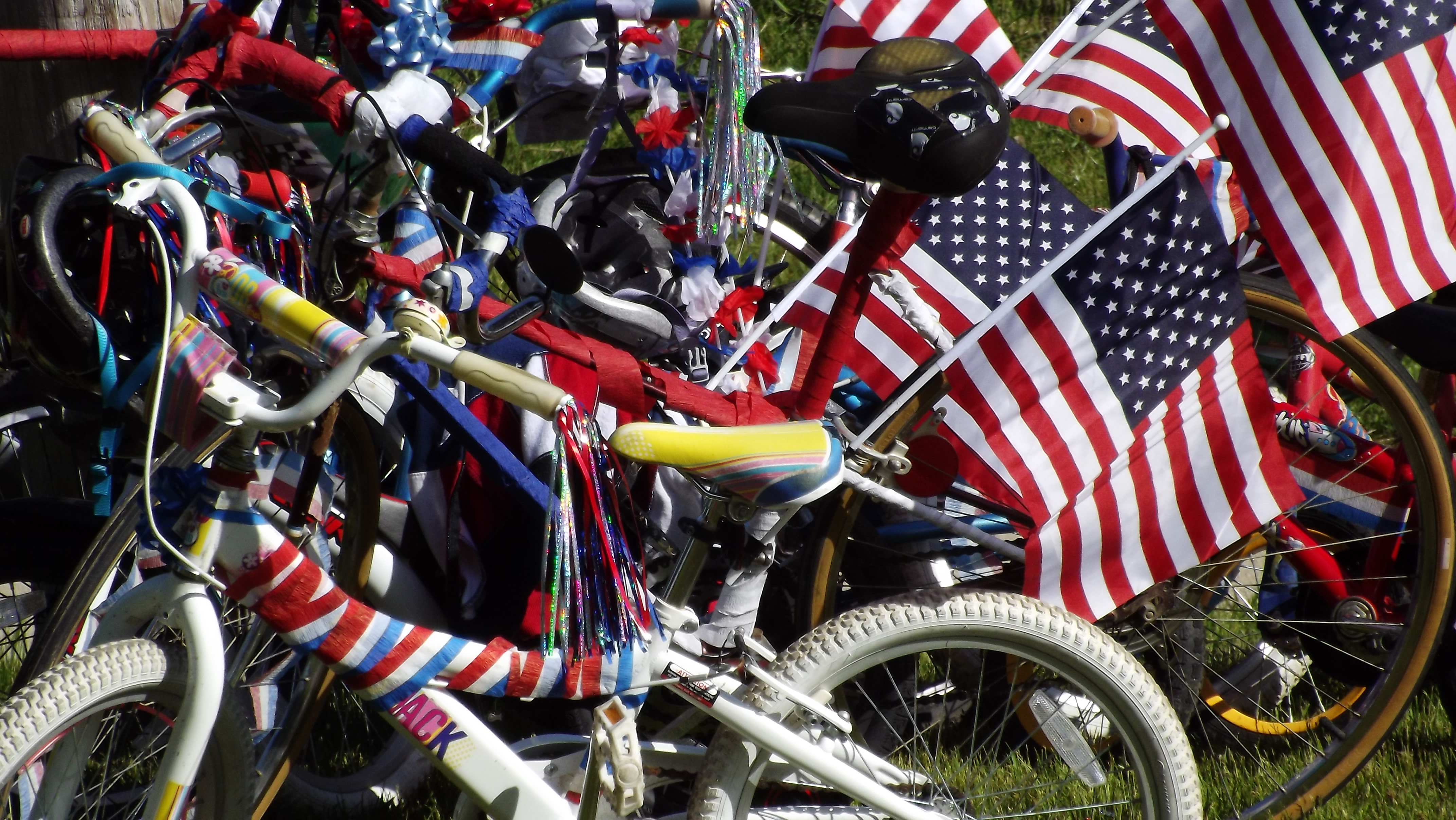 red white and blue decorated bicycles with streamers and flags
