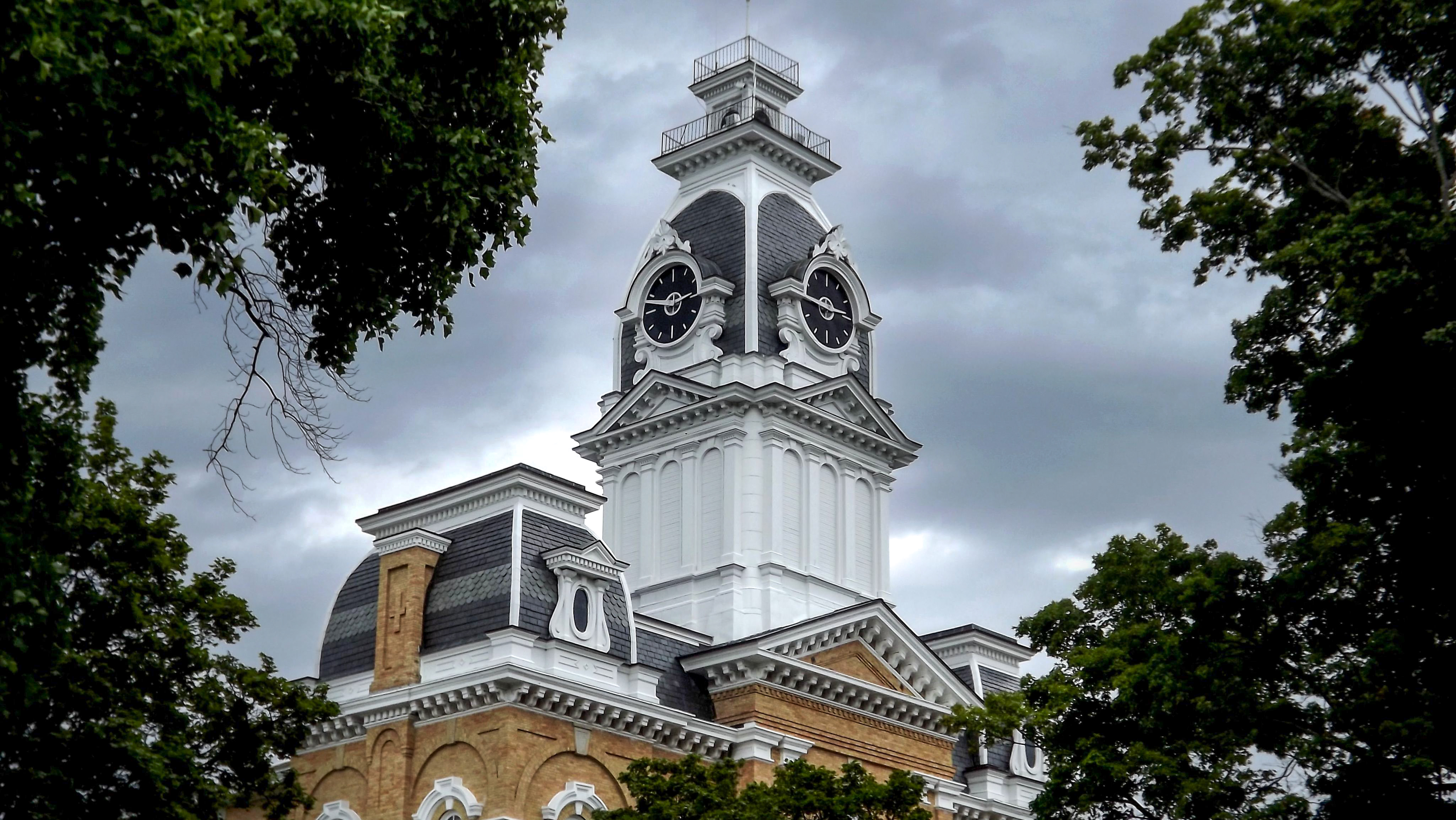 Clocktower building with ominous clouds