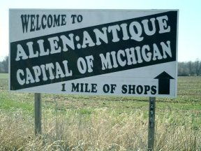 Sign welcome to Allen: Antique Capital of Michigan