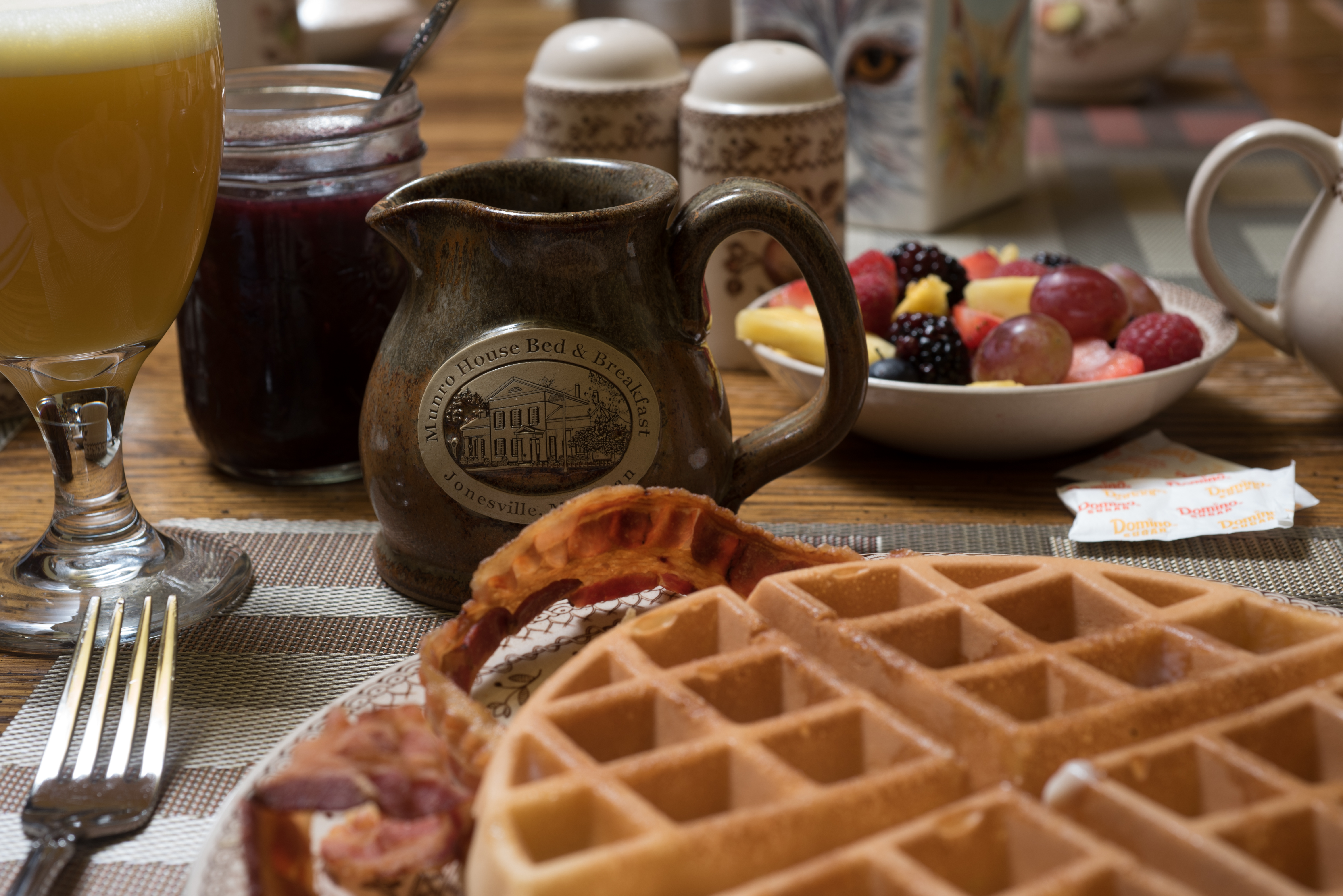 Breakfast at Munro House Waffle Orange Juice Fresh Fruit