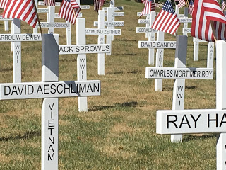 white crosses with names and era of fallen soldiers in Hillsdale County Michigan