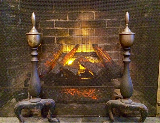 brick fireplace with glowing embers