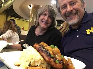 Michigan fan and his wife enjoy Pork Rib Eye with Fuji Apples