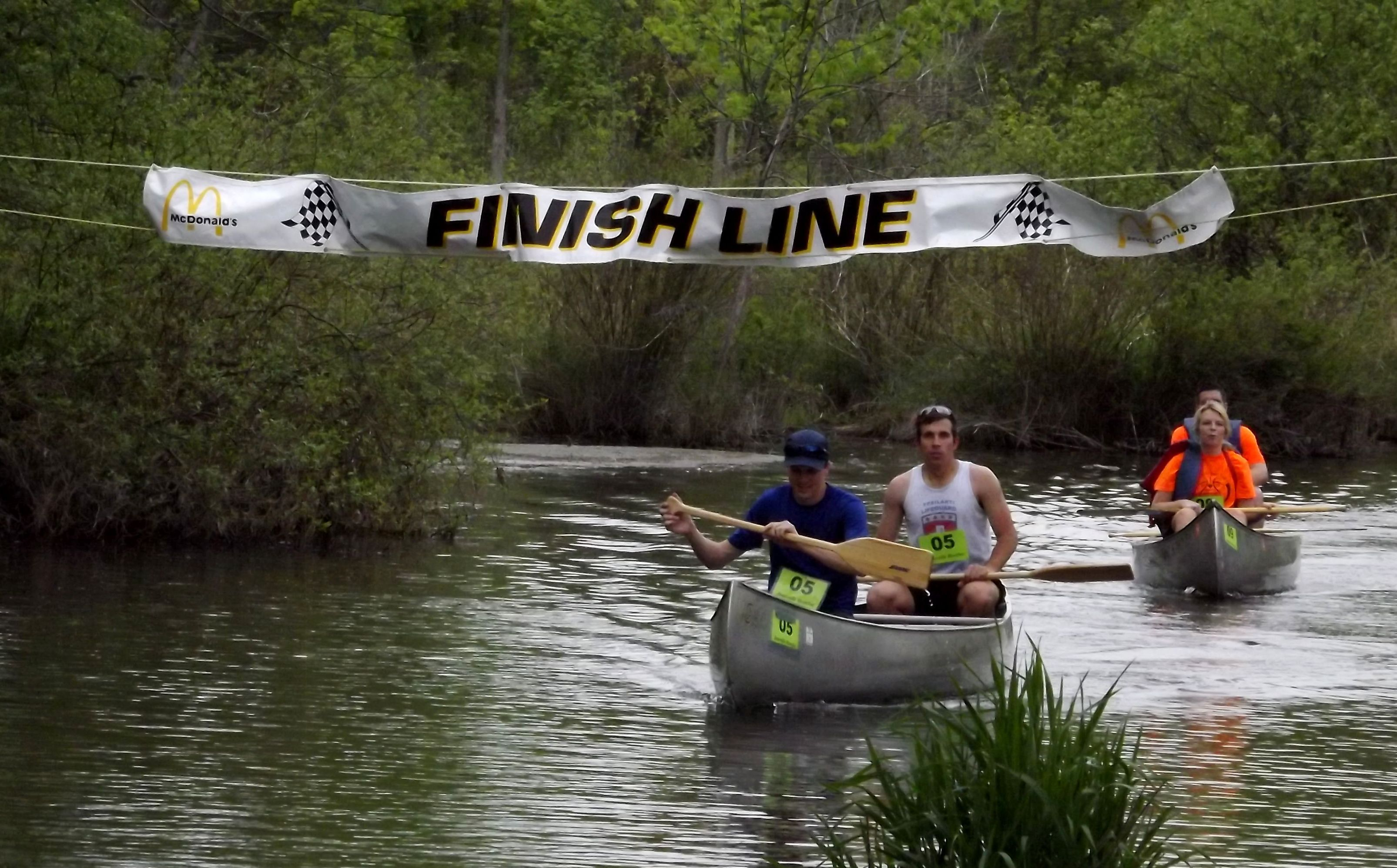 finish line of canoe race on river