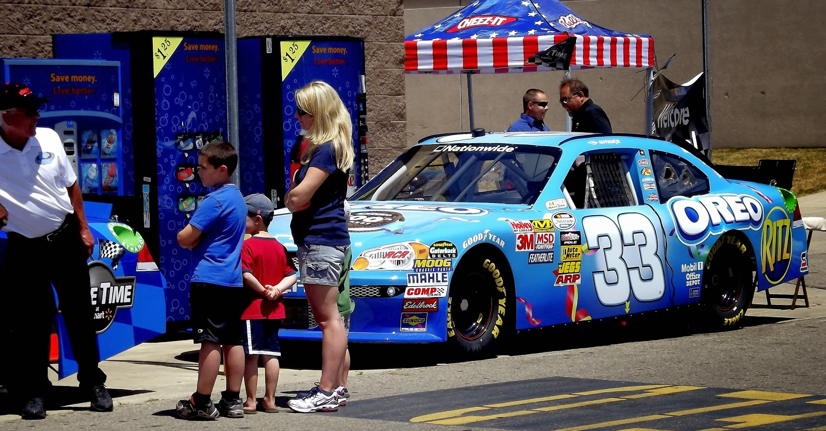 Blue #33 race car with young and old fans
