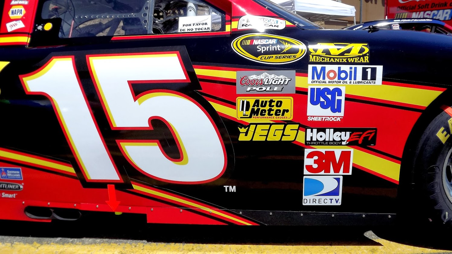 side of #15 race car with multiple sponsor logos