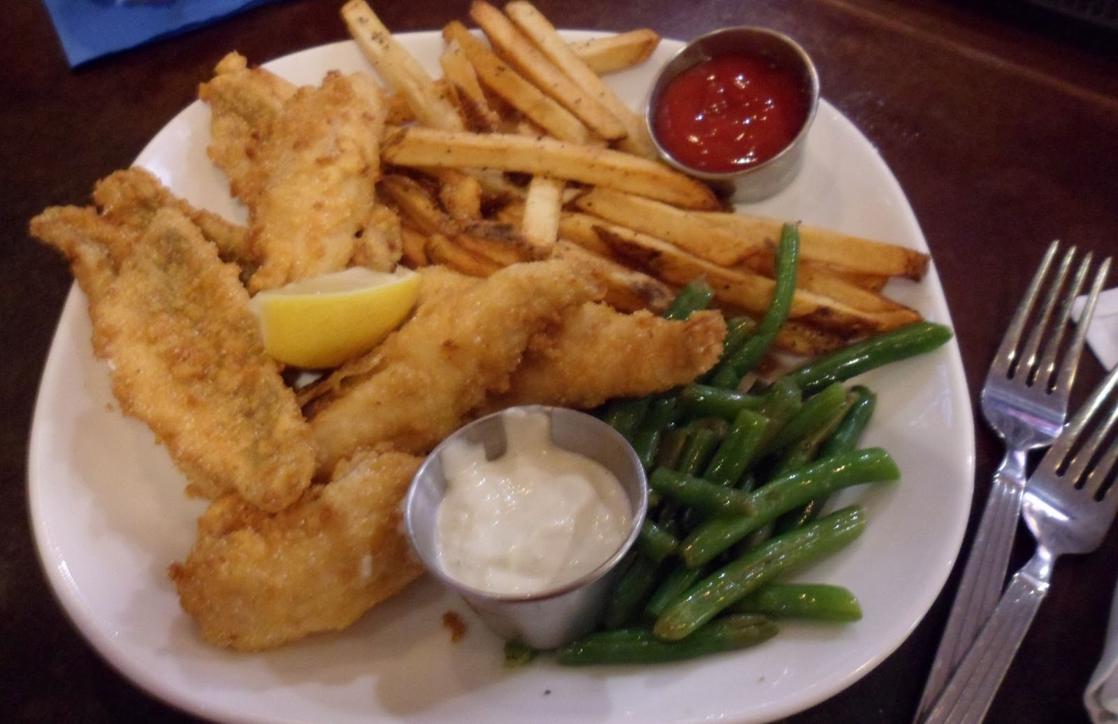 fried fish dinner with french fries and green beans on a white plate