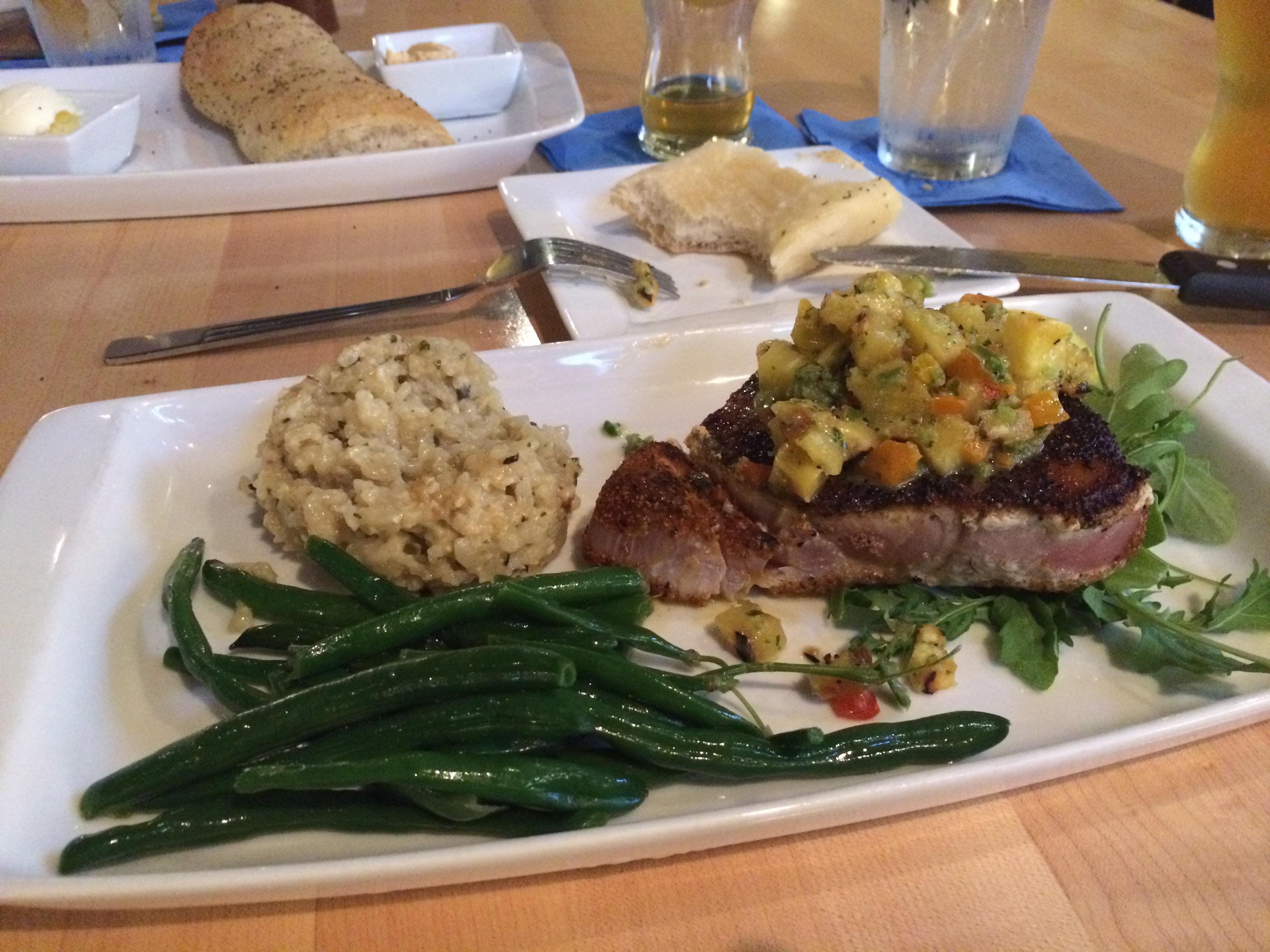 Steak dinner on fancy plate at Olivia's Chop House