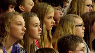 Students attend veterans day memorial service at Jonesville Michigan middle school gym