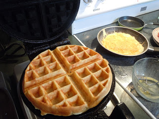 waffle iron with lightly browned waffle