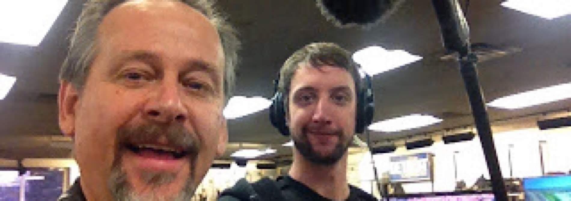 2 guys under a boom mic