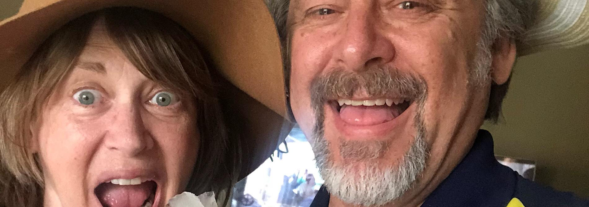 man with woman open mouth wearing floppy hat
