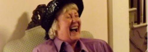 woman laughing big