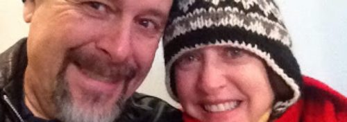 man and woman wearing winter hats