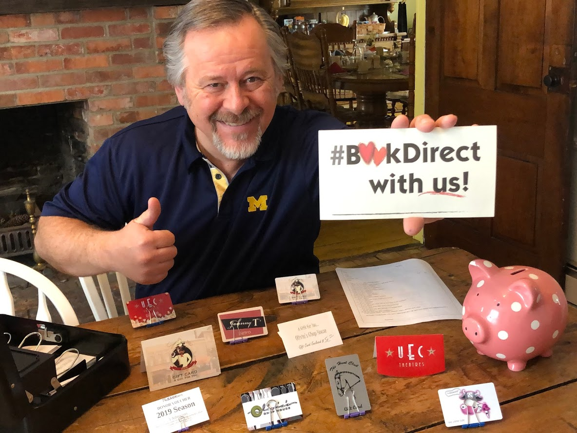 man with thumbs up promoting #bookdirect with us
