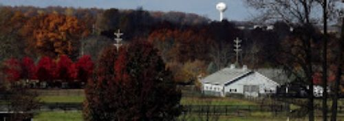 fall colors country scene with white water tower