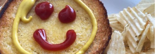 burger with happy face made from ketchup and mustard