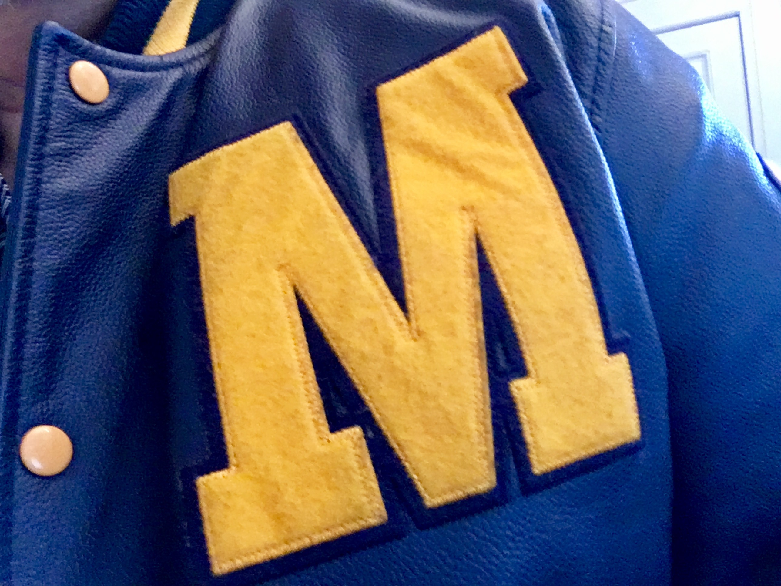 University of Michigan letterman jacket logo