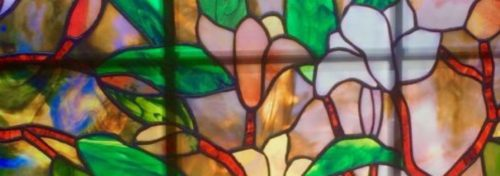 stained glass window green yellow pink red