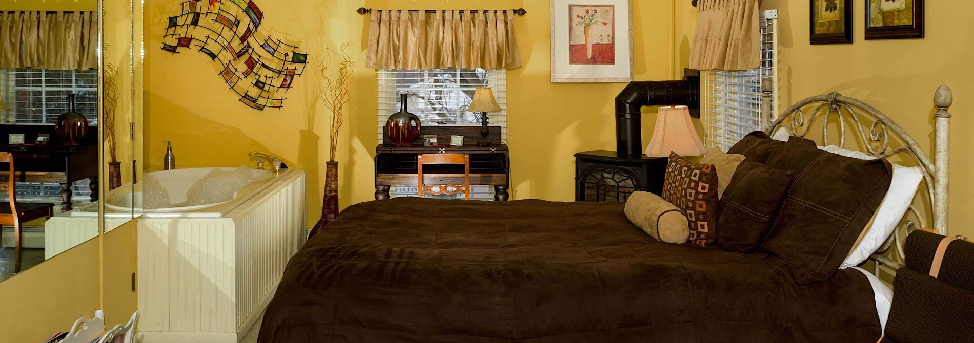 modern Bedroom with yellow walls and brown comforter