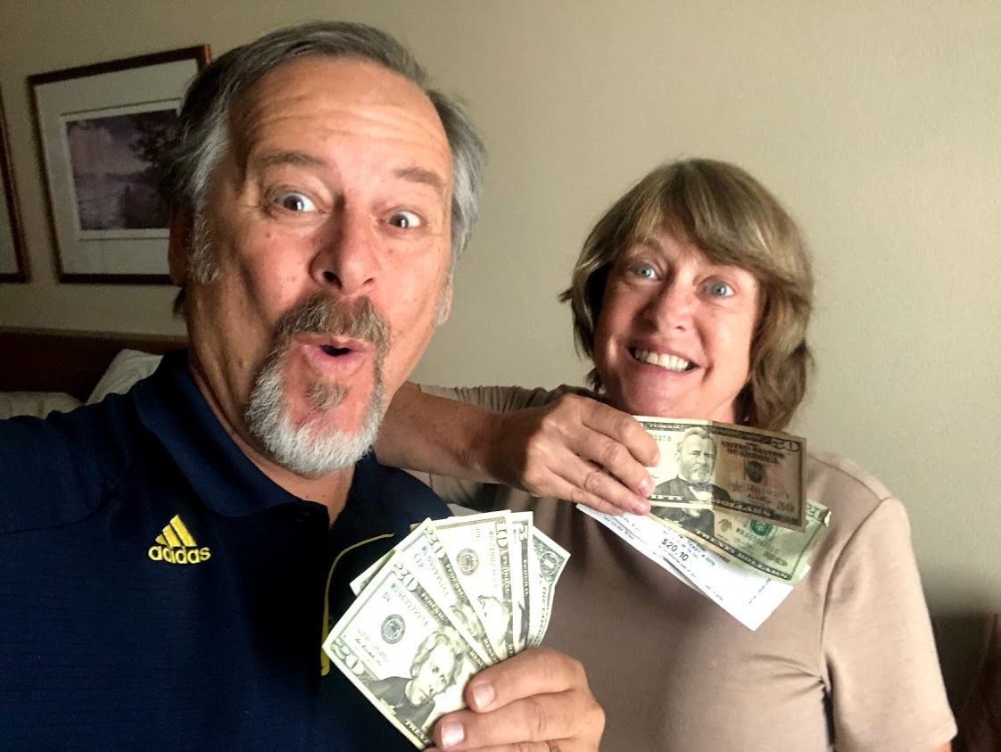 Man and woman fanning money saved