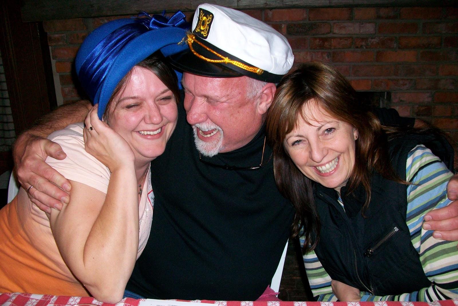 Happy Murder Mystery man and woman in fancy hats
