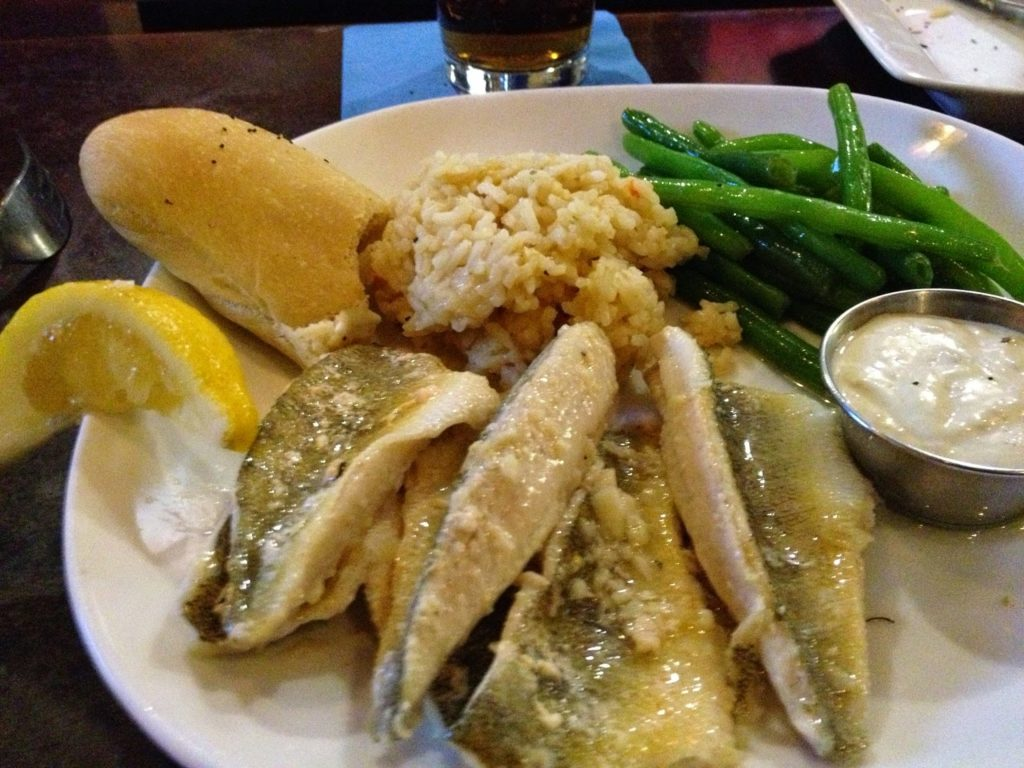 fish fry at olivias chop house with lemon and green beans