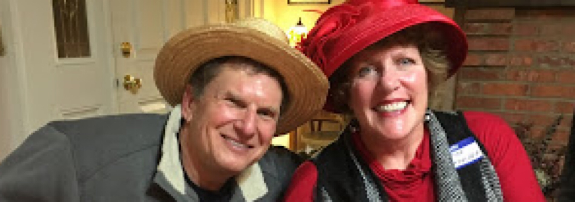 man with woman in red hat