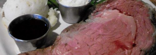 red rare steak with tin cup of au jus