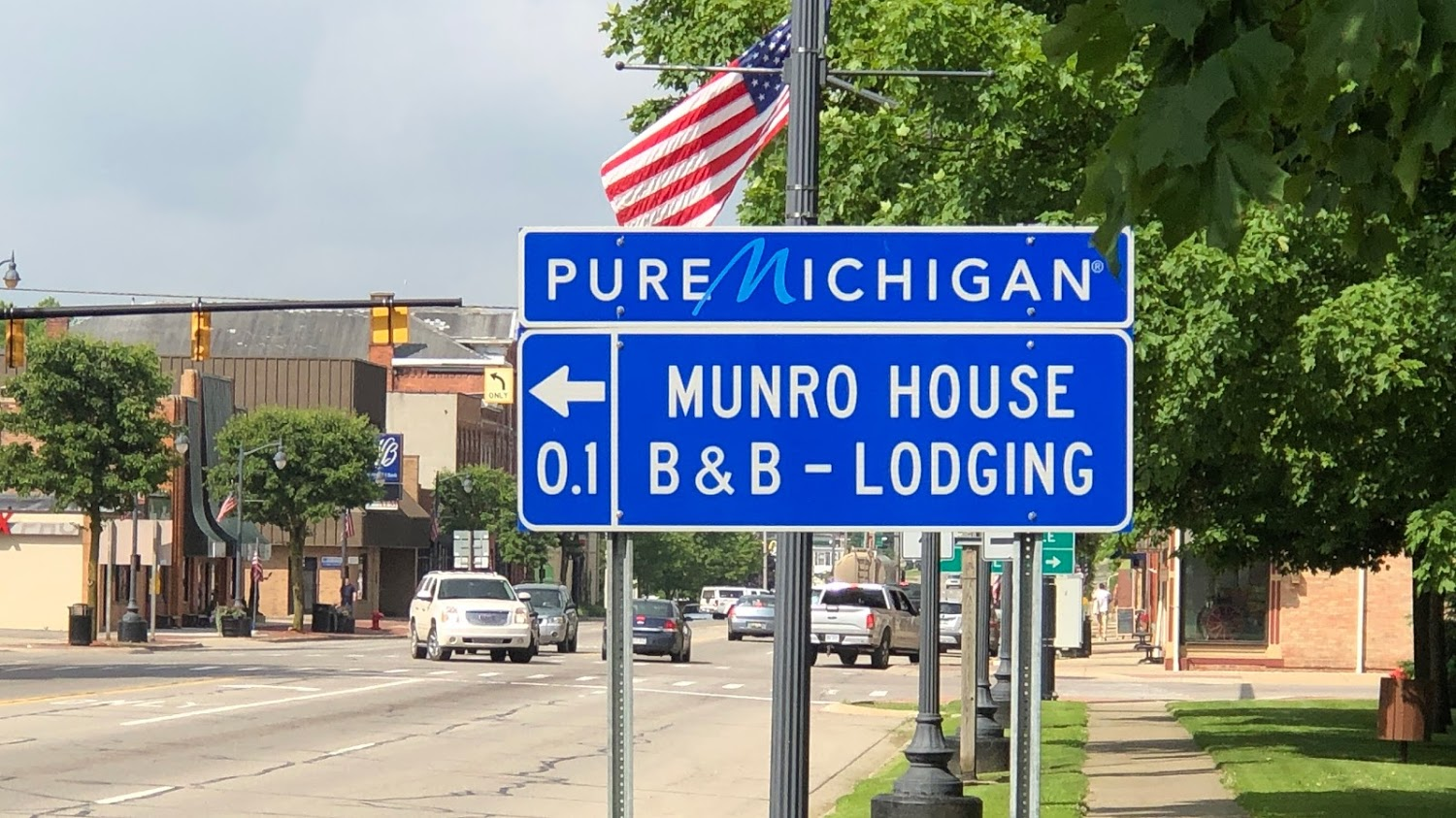 blue highway sign with white lettering  and pure michigan motto