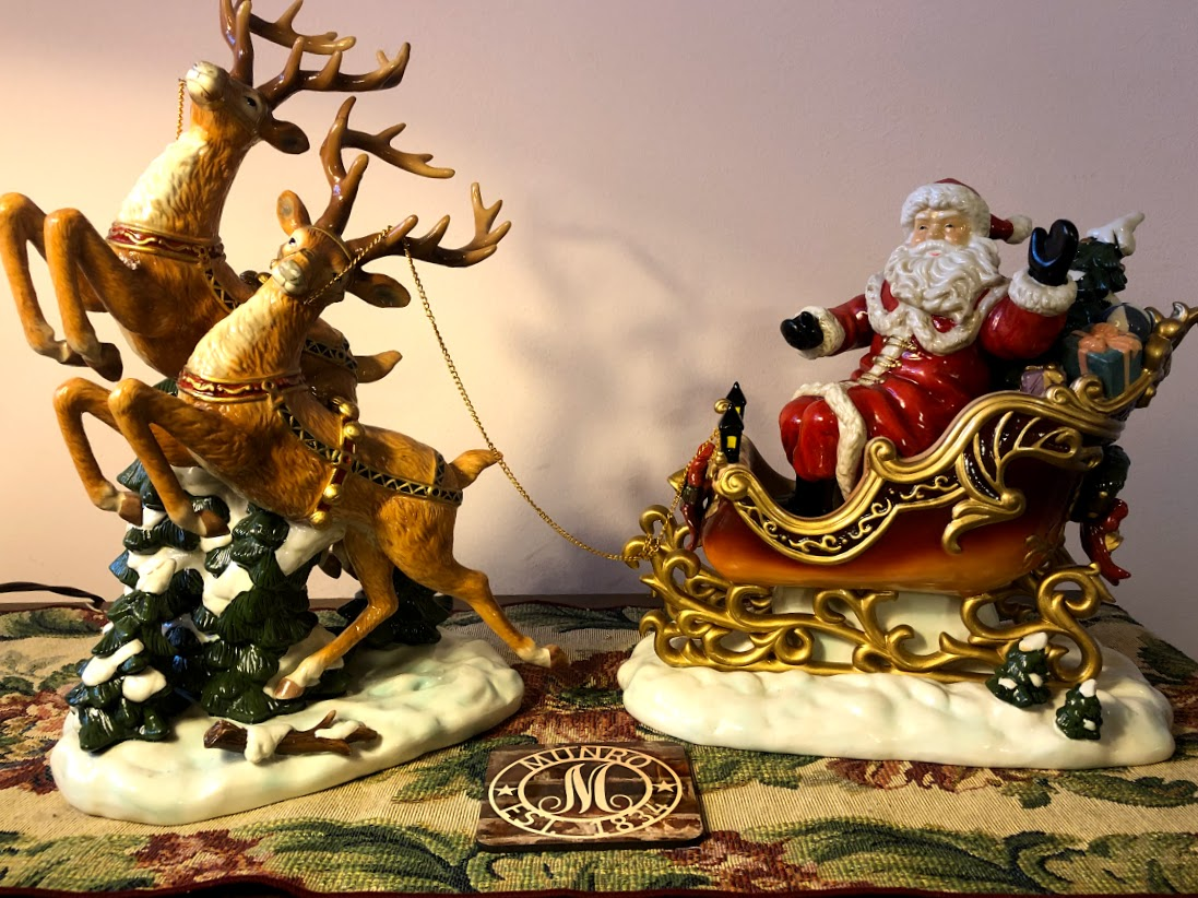 porcelain santa claus in sleigh with reindeer