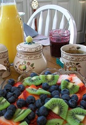 fruit bowl with berries and orange juice