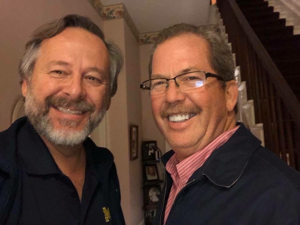 2 smiling men