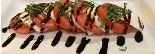 red tomato salad with white mozzarella cheese and balsamic vinegar