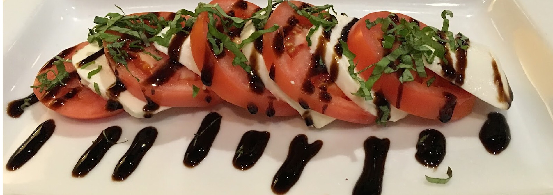 red tomato salad with white mozzarella cheese and balsamic vinegar